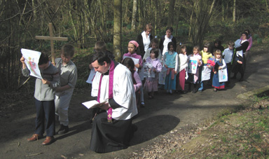The children hold the Stations of the Cross